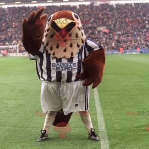 Hnědý a béžový ptačí maskot ve sportovním oblečení -
