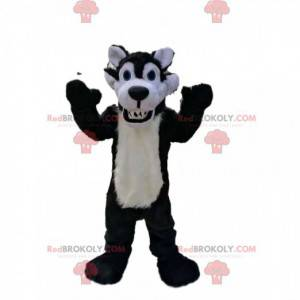 Sehr bestialisches Schwarz-Weiß-Wolfsmaskottchen -