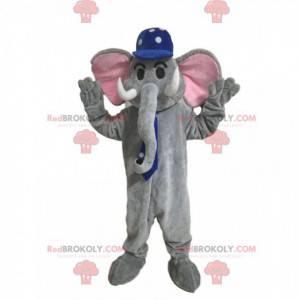 Mascotte elefante grigio con un berretto blu con punti bianchi