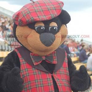 Schwarz-Braun-Bären-Maskottchen in schottischer Kleidung -