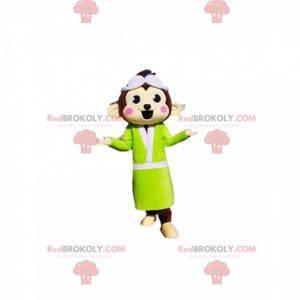 Braunes Affenmaskottchen mit einem neongelben Bademantel -