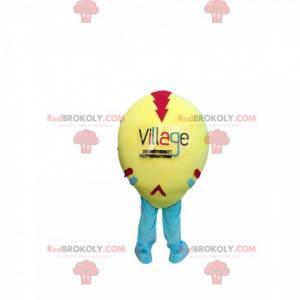 Żółta i wielobarwna piłka maskotka z ładnym uśmiechem -