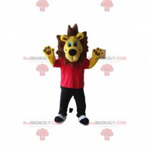 Gul løvemaskott med rød t-skjorte og svarte bukser -
