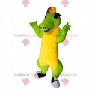 Mascotte coccodrillo verde e giallo con un berretto -