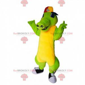 Zelený a žlutý krokodýlí maskot s víčkem - Redbrokoly.com