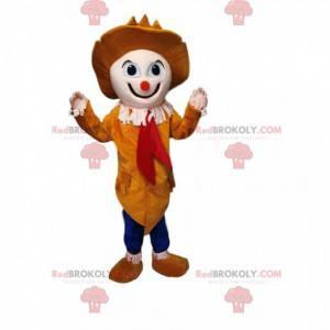 Clown mascotte met een kleine oranje neus en een mooie gele