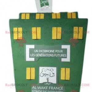 Grünes Gebäudemaskottchen mit gelben Fenstern - Redbrokoly.com