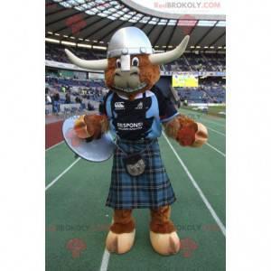 Hnědý býk kráva maskot s kilt a helmu - Redbrokoly.com