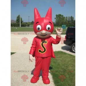Mascota de superhéroe con una máscara y un traje rojo. -