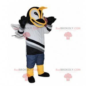 Mascote do abelha com uma camisa preta e branca - Redbrokoly.com