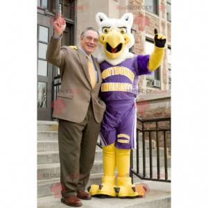 White and yellow eagle bird mascot in sportswear -