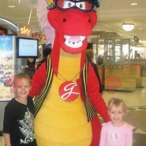Maskot červený a žlutý dinosaurus s brýlemi - Redbrokoly.com