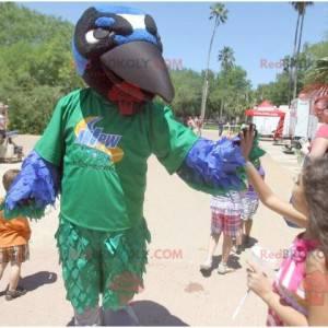 Maskottchenvogel grün blau weiß und schwarz Rabe -