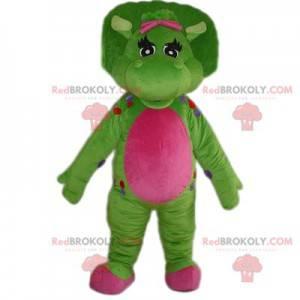Mascote de dinossauro muito bonito verde e fúcsia -