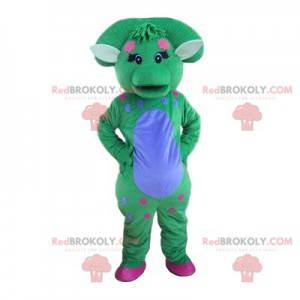 Mascota dinosaurio azul y verde pastel con una bocanada -