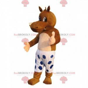 Mascote hipopótamo marrom com shorts brancos e bolinhas azuis -