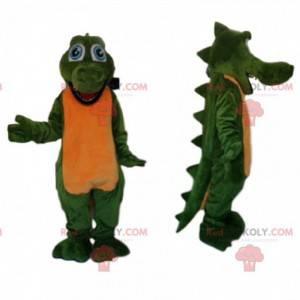 Engraçado mascote crocodilo verde com grandes olhos azuis -