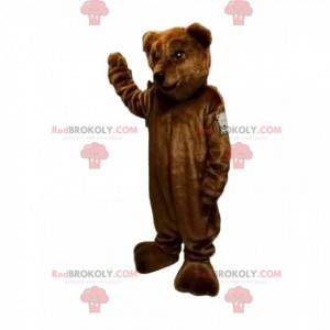 Brown bear mascot with a beautiful muzzle and a nice smile -
