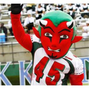 Rotes und grünes Teufelsmaskottchen in der Sportbekleidung -