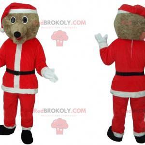 Beiges Hundemaskottchen mit dem Kostüm der Weihnachtszeit -