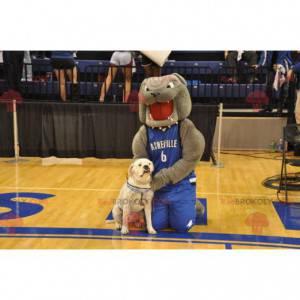 Graues Bulldoggenmaskottchen in blauer Sportbekleidung -