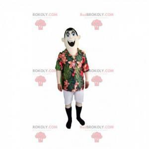 Maskot upíra s tropickou košilí a bílými kalhotami -