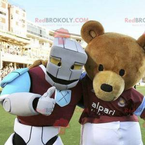 2 mascots a brown bear and a white blue and purple robot -