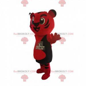 Sehr fröhliches rotes und schwarzes Tigermaskottchen -