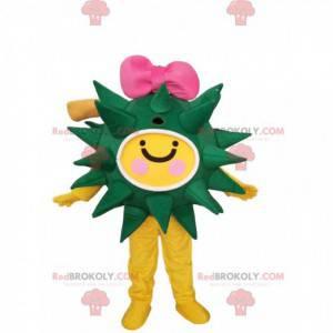 Grünes und gelbes Virusmaskottchen mit einer rosa Fliege -