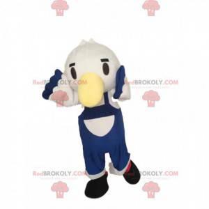 Maskottchen kleiner weißer Vogel mit blauen Overalls -