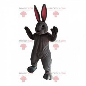 Grå kaninmaskot med enorme rosa ører - Redbrokoly.com