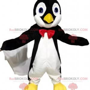 Mascotte del pinguino in bianco e nero con un farfallino rosso