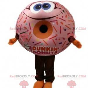 Mascote donut com cobertura rosa e um grande sorriso -