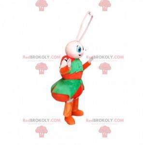 Mascote formiga branca com uma roupa vermelha e verde -