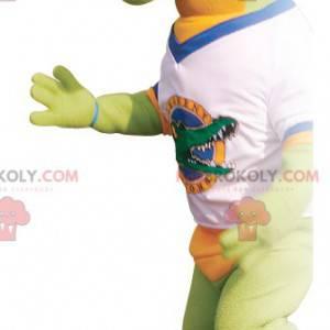 Zelený a oranžový maskot krokodýla s tričkem - Redbrokoly.com