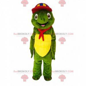 Grünes Schildkrötenmaskottchen mit einer bunten Kappe und einem