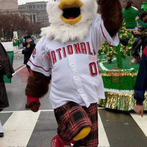 White and brown eagle mascot in sportswear with a kilt -