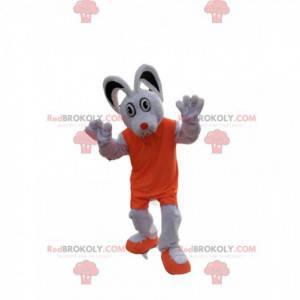 Mascotte del topo bianco con un vestito arancione -