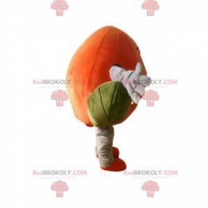 Orange Pfirsich Maskottchen mit hübschen grünen Blättern -