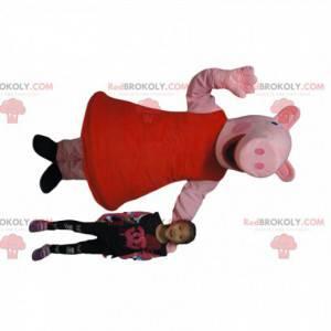 Bardzo uśmiechnięta świnia maskotka w czerwonej sukience -