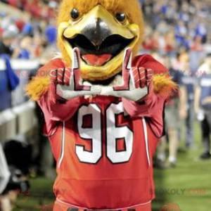 Oranžový orel pták maskot v červené sportovní oblečení -