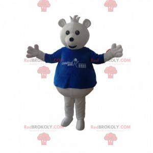 Weißes Bärenmaskottchen mit einem blauen T-Shirt -
