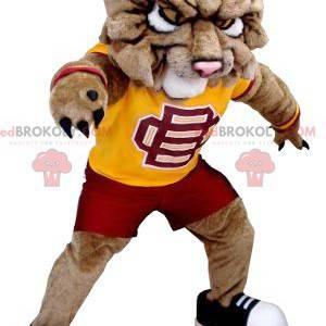 Brązowy pies maskotka lew w odzieży sportowej - Redbrokoly.com