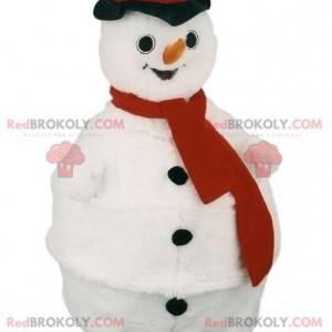Sneeuwman mascotte met een rode sjaal en een zwarte hoed -
