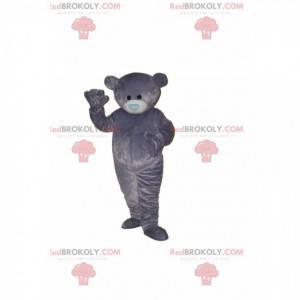 Gray bear mascot with a blue heart-shaped muzzle -