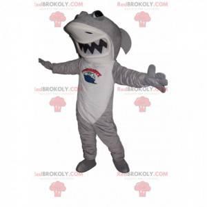 Mascot tiburón gris y blanco con una gran mandíbula -