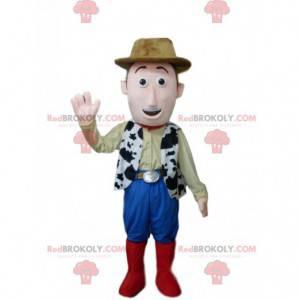 Uśmiechnięty kowbojski maskotka z brązowym kapeluszem -