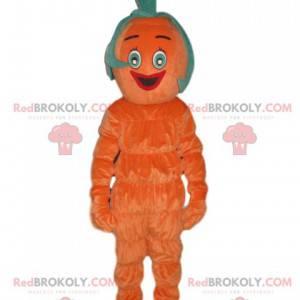 Uśmiechający się pomarańczowy bałwan maskotka z dziwacznymi