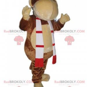 Mascota divertida del mono con una bufanda roja y verde -