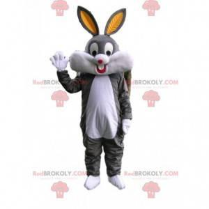 Velmi šťastný maskot šedého a bílého králíka s velkými ušima -